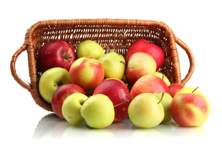 juicy apples in basket, isolated on white photo