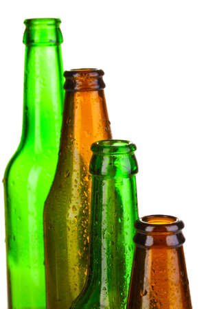 Colorful empty glass bottles isolated on white photo
