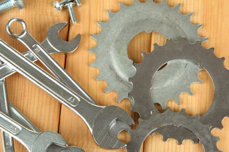 Machine gear, metal cogwheels, nuts and bolts on wooden background Stock Photo - 17144265