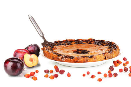 Tasty pie on plate with plums isolated on white Stock Photo - 17140372