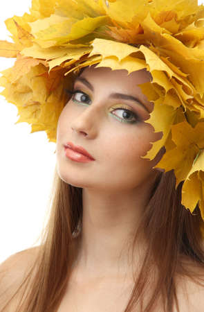 beautiful young woman with yellow autumn wreath, isolated on white photo