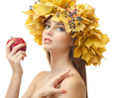 beautiful young woman with yellow autumn wreath and apple, isolated on white photo