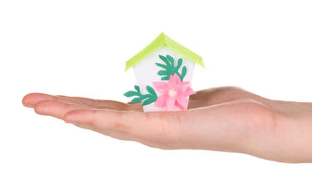 Small house in hand isolated on white Stock Photo - 17139639