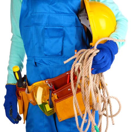Male builder in blue overalls with rope and helmet isolated on white photo