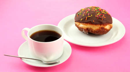 Tasty donuts on color plate on color background photo