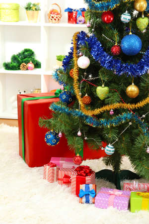 Decorated Christmas tree on home interior background photo