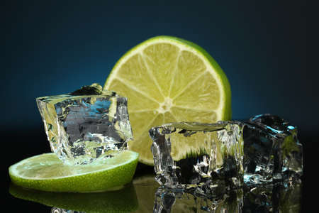 darck: Ice cubes with lime on darck blue background