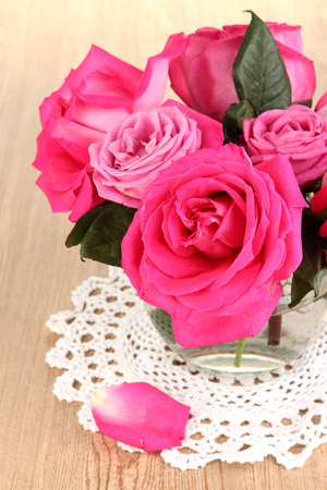 Beautiful pink roses in vase on wooden table close-up Stock Photo - 17143603
