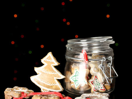 Christmas treats in bank on Christmas lights background photo