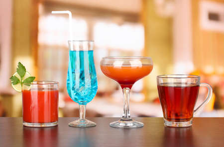 Several glasses of different drinks on bright background Stock Photo - 17140875