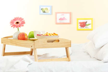 wooden tray with light breakfast on bed Stock Photo - 17214360