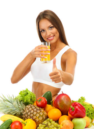 beautiful young woman with fruits and vegetables and glass of juice, isolated on white Stock Photo - 17282020