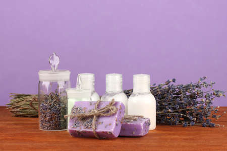 ingredients for soap making on violet background photo