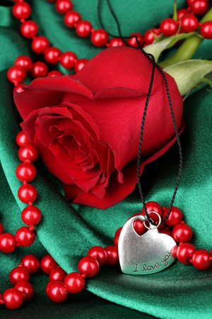 Beautiful red rose with heart pendant Stock Photo - 17215237