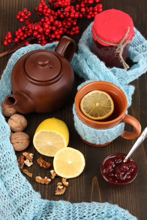 Helpful tea with jam for immunity on wooden table close-up photo