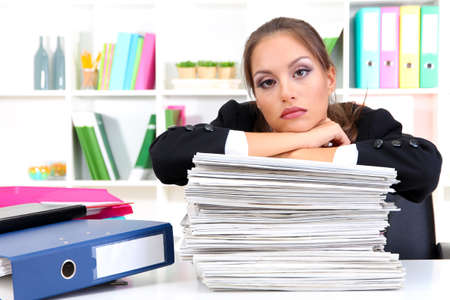 secretary woman: Sad business woman with documents in her workplace Stock Photo