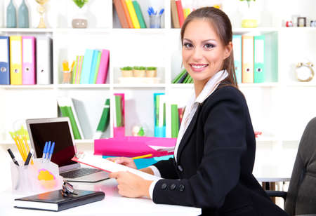 Young pretty business woman at workplace Stock Photo - 17282159