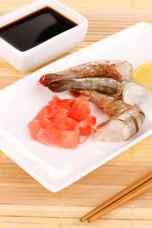 prawn skewers: Prawn skewers on plate with ginger and lemon Stock Photo