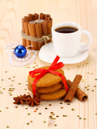 Cookies for Santa: Conceptual image of ginger cookies, milk and christmas decoration on light background photo