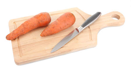 carrots and knife on wooden cutting board isolated on white photo