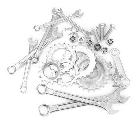 Machine gear, metal cogwheels, nuts and bolts isolated on white Stock Photo - 17214421