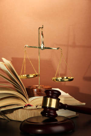 Golden scales of justice, gavel and books on brown background Stock Photo - 17214917