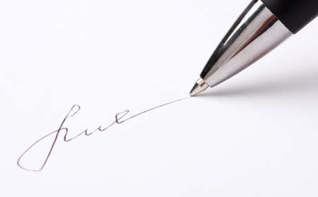 Closeup of signature (fake, not real) and pen, isolated on white photo