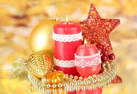 Red candle with christmas decoration on bright background Stock Photo - 17214843