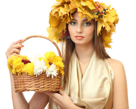 beautiful young woman with yellow autumn wreath and basket with flowers, isolated on white Stock Photo - 17282909