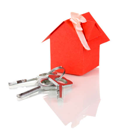 Small house with key isolated on white photo