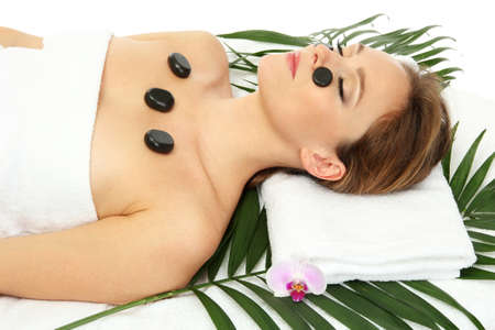 Portrait of beautiful woman with spa stones photo