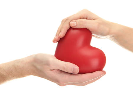 Red heart in woman and man hands, isolated on white photo