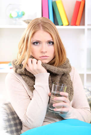 Sick woman with cold sitting on sofa Stock Photo - 17281352