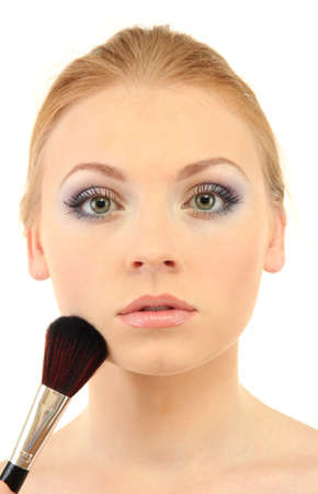portrait of beautiful woman   with make-up brush for powder, isolated on white photo