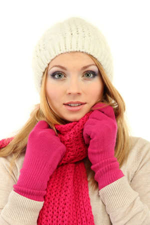 Young beautiful woman wearing winter clothing, isolated on white photo