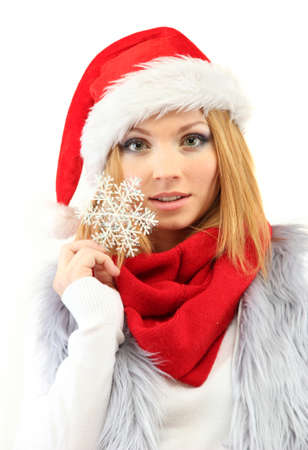 Attractive young woman holding decorative snowflake isolated on white photo