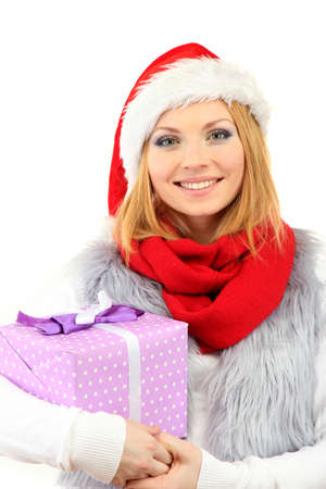 Attractive young woman holding Christmas gift, isolated on white photo