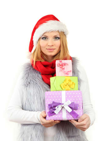 Attractive young woman holding Christmas gifts, isolated on white photo