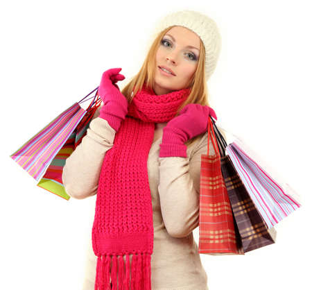 Attractive young woman woman with lot of shopping bags, isolated on white photo