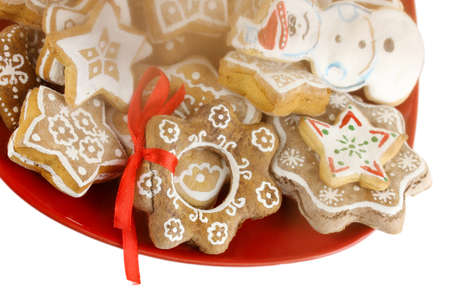 kiss biscuits: Christmas treats on plate isolated on white