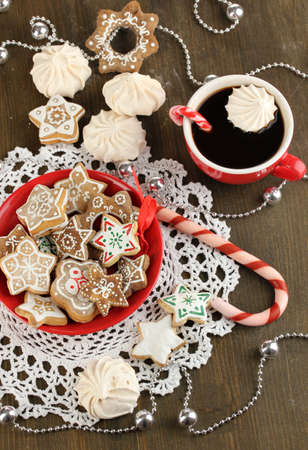 Christmas treats on plate and cup of coffe on wooden table close-up Stock Photo - 17216672