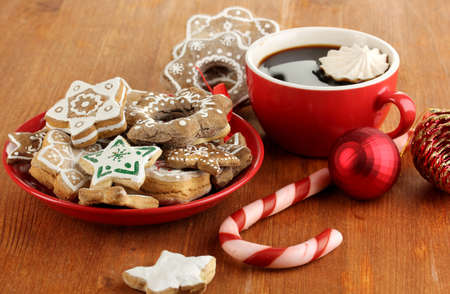 Christmas treats on plate and cup of coffe on wooden table close-up Stock Photo - 17216592