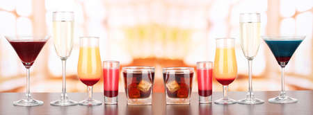 Several glasses of different drinks on bright background Stock Photo - 17238987