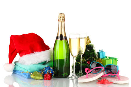 Beach accessories champagne and Christmas tree isolated on white photo