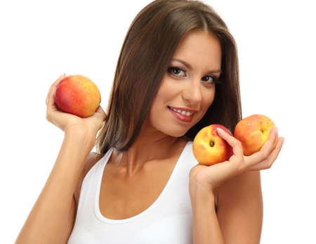 beautiful young woman with  peaches, isolated on white photo