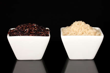 Black & white rice isolated on black photo
