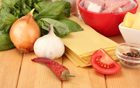 Lasagna ingredients on wooden background photo