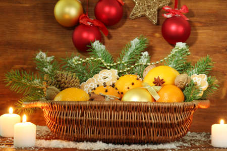 christmas composition in basket with oranges and fir tree, on wooden background Stock Photo - 17257048