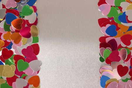Hearts confetti on gray background photo