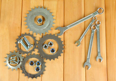 Machine gear, metal cogwheels, nuts and bolts on wooden background Stock Photo - 17257124